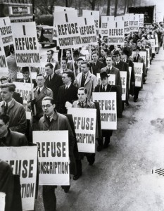 11 May 1939, London, England, UK --- 5/11/1939-London, England: Members of Britain's No Conscription League parade in protest of the government's compulsory conscription bill. Some of the 2,000 in the parade are shown carrying posters. --- Image by © Bettmann/CORBIS